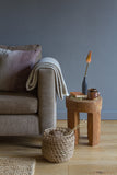natural linen cushion with earthy colour gradient living room