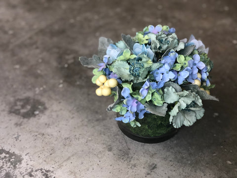 Faux Blue Hydrangeas and Blue Scabiosas in a Low Cylindrical Case