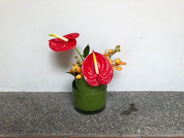 Red Anthuriums & Orange Orchids Cocktail Arrangement