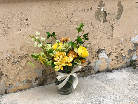 Faux Yellow Ranunculuses In A Flared Vase