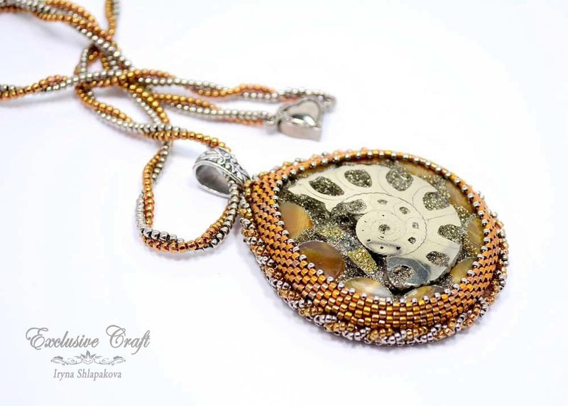 handcrafted bead embroidered brown bronze ammonite pendant