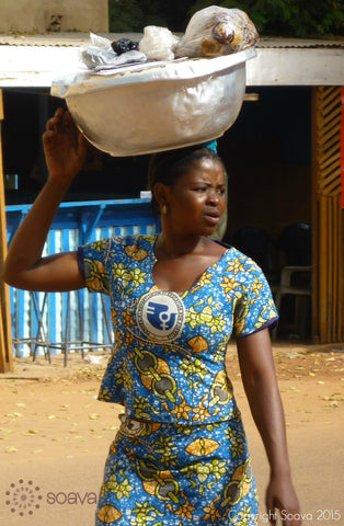 A young woman with her March 8th, International Woman's Day outfit in the streets of Ouagadougou, Capital of Burkina Faso