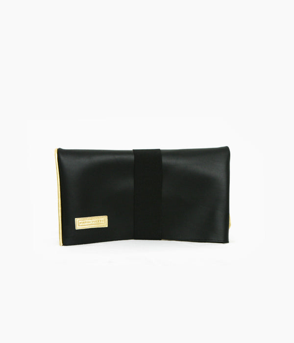 golden clutch bag with black leather reversible bag