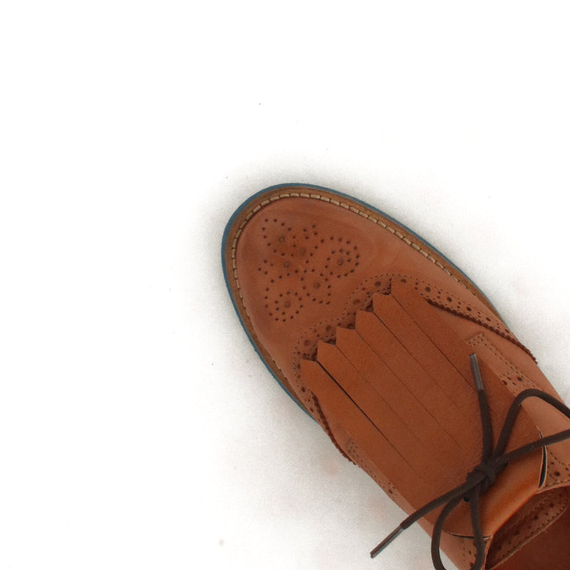 Fringe Shoe Accessory in brown shoes in brown leather