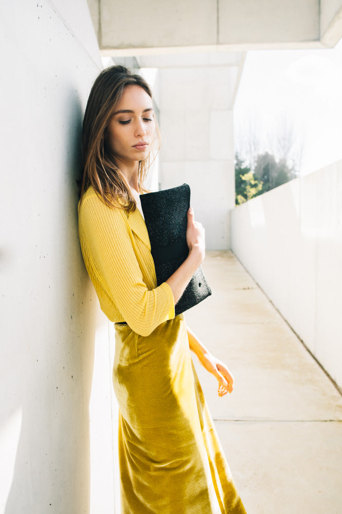 outfit with black clutch bag yellow skit in velvet