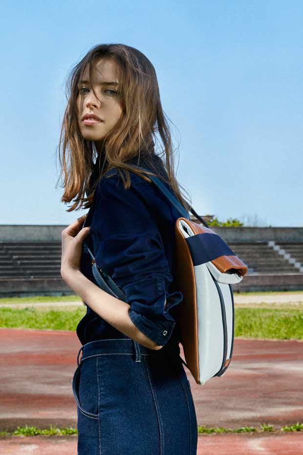 women backpack white and blue navy jeans outfit