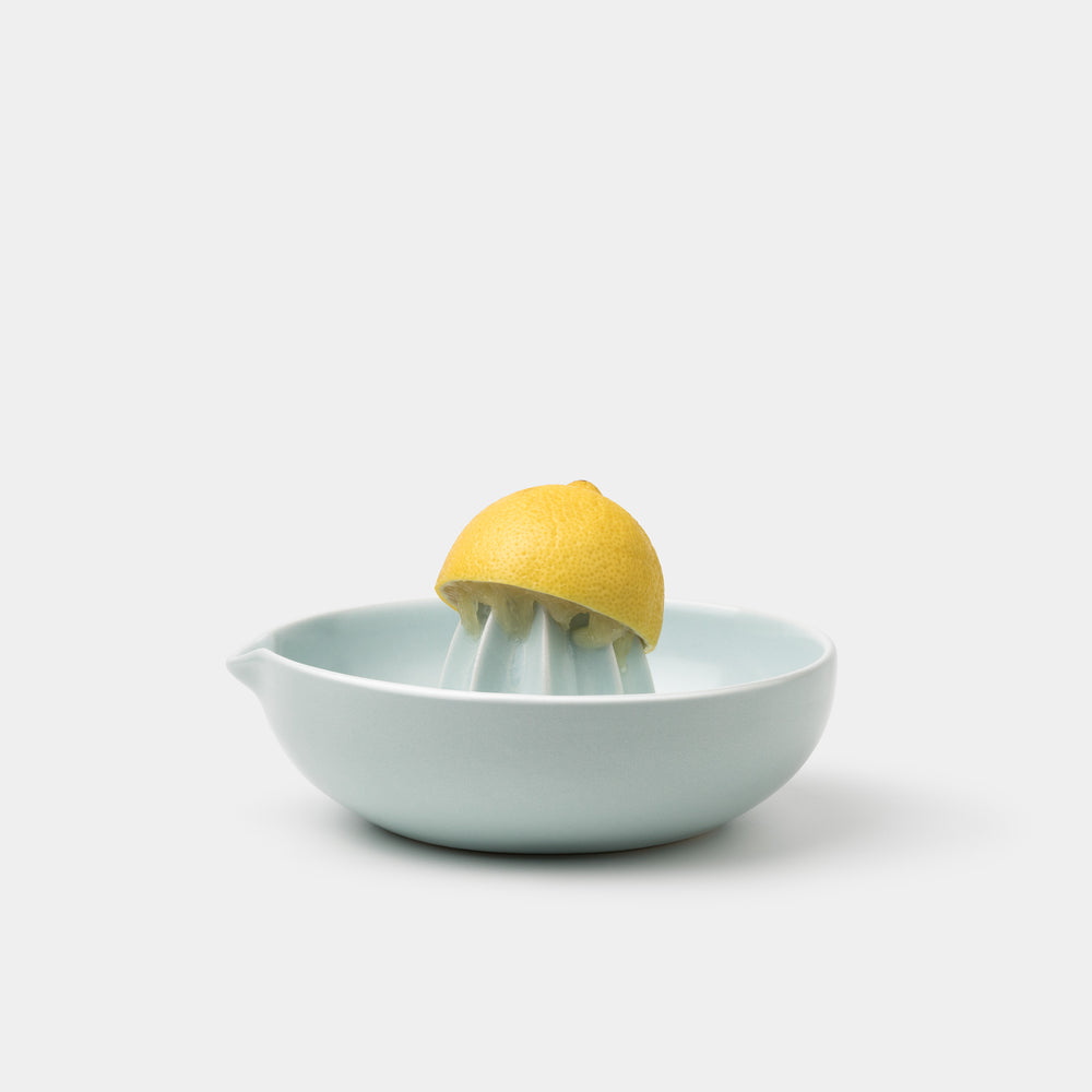 Gidon Bing Citrus Juicer Satin Eggshell Blue with lemon