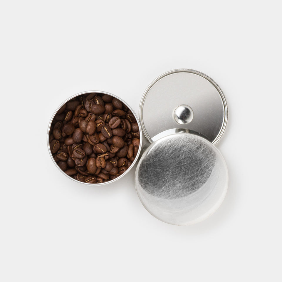 Syuro Canister (Set of Two) lids open top with coffee