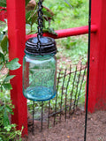 blue ball mason jar solar light hanging.