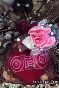 carved soapstone heart talisman