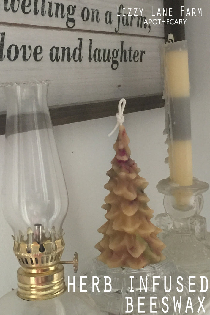 rose and bay leaf infused beeswax tree candle