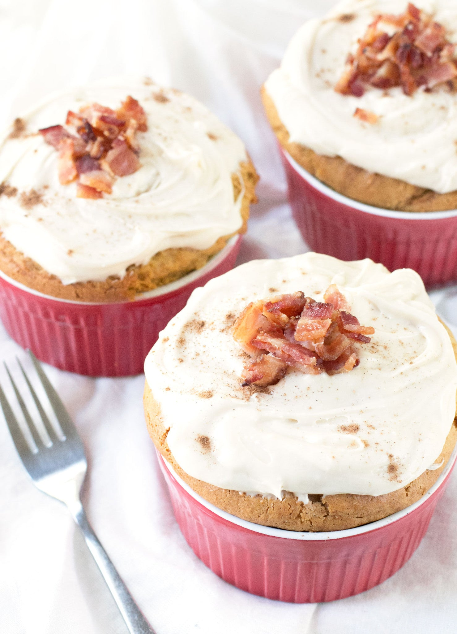 Individual Pumpkin Spice Cakes with Cream Cheese Frosting and Candied Bacon | Sauce + Style