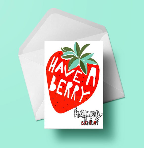 A greeting card showing a picture of a red strawberry Have a Berry Happy Birthday.