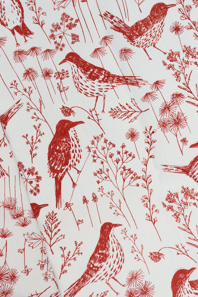 Screen printed fabric with red brown thrashers