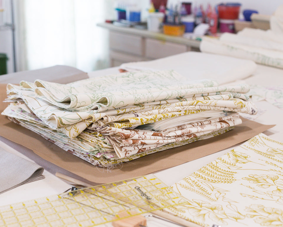 piles of table runners by Sara Parker Textiles