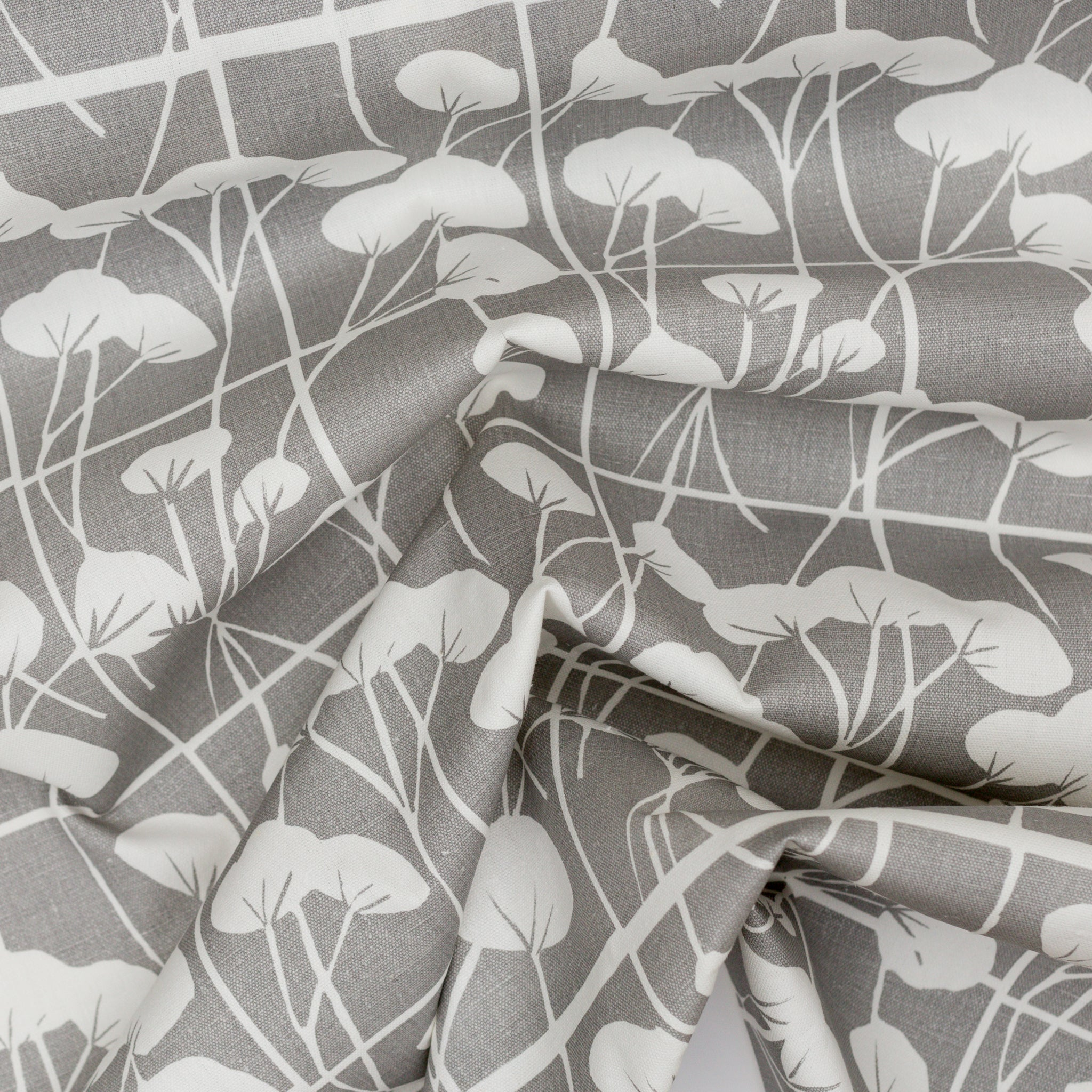 Screen printed fabric with cotton plants in pebble