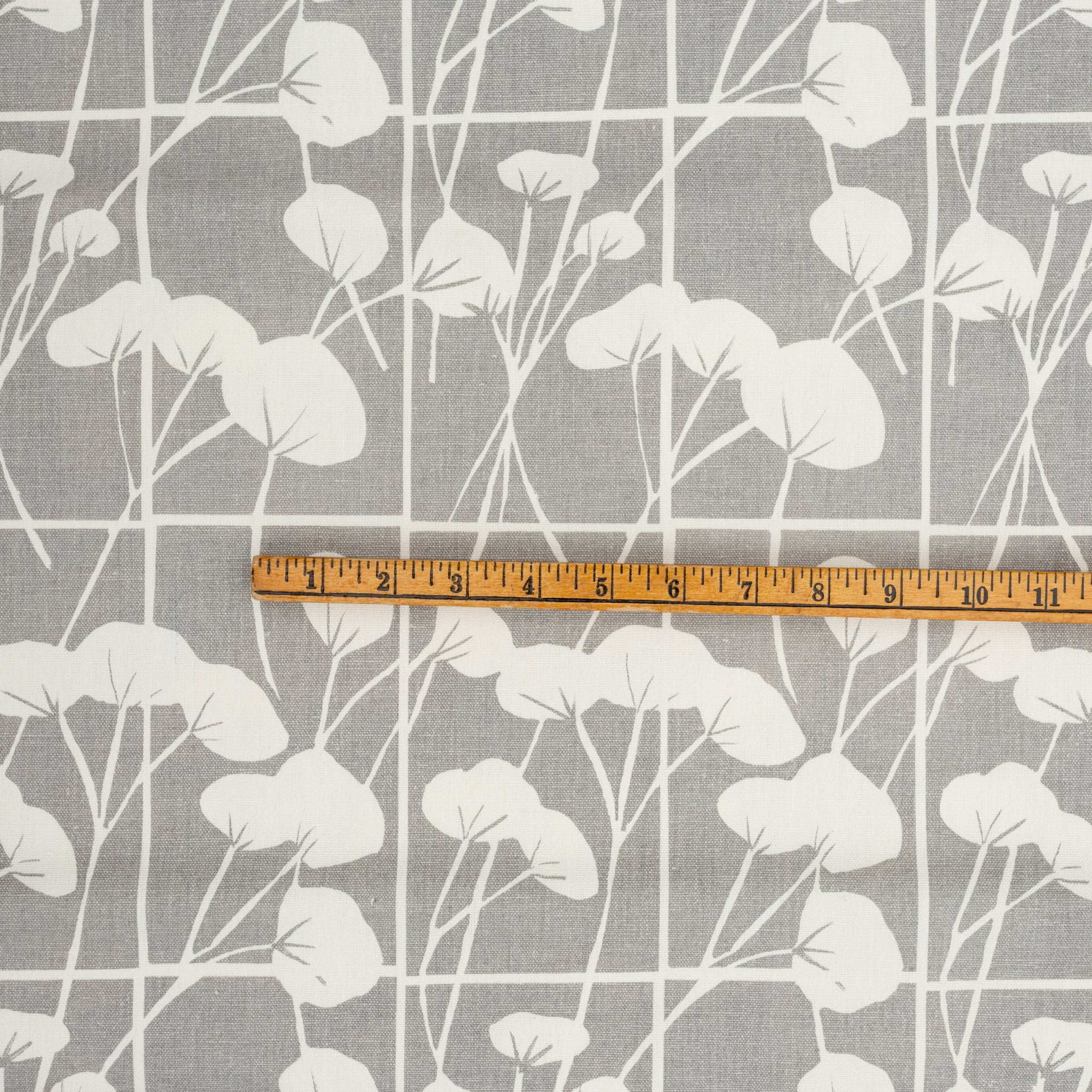 Screen printed fabric yardage with cotton plants and yardstick