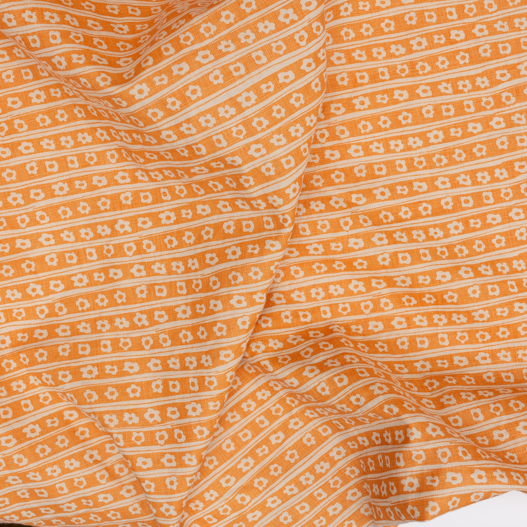 Daisy Pinstripe in Clementine screen printed onto linen fabric