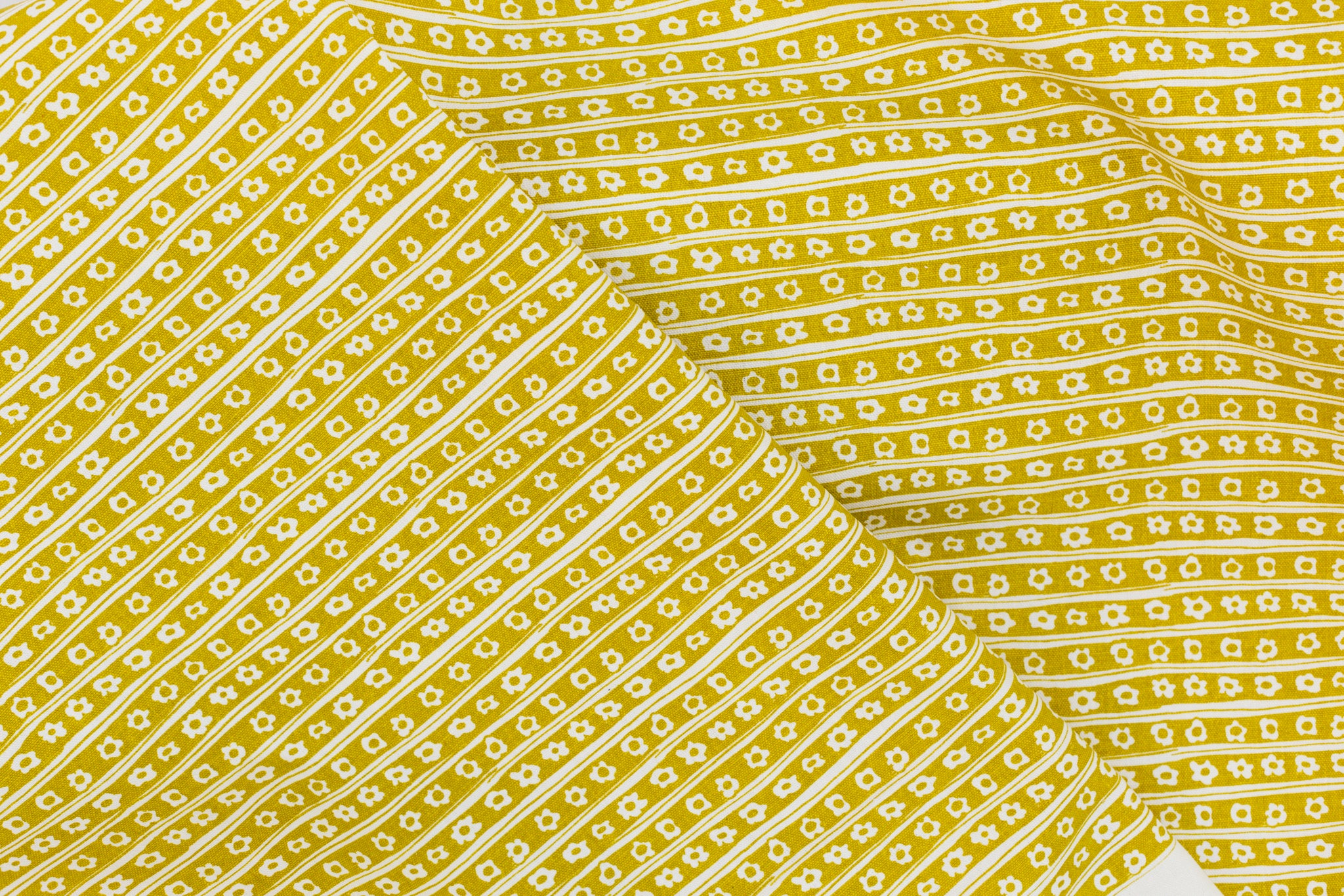 Screen printed fabric yardage with daisy pinstripes