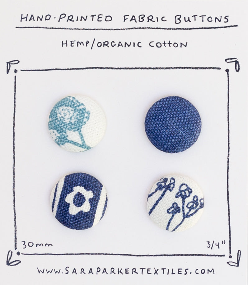 Four hand-printed fabric buttons