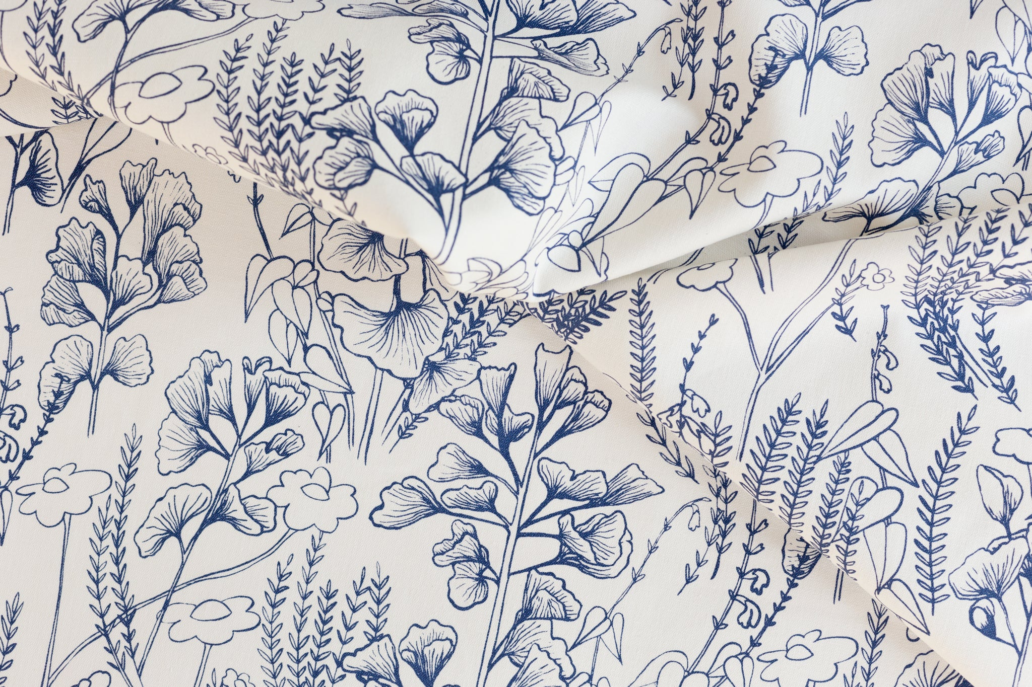 Ginkgo in Indigo screen printed onto fabric yardage