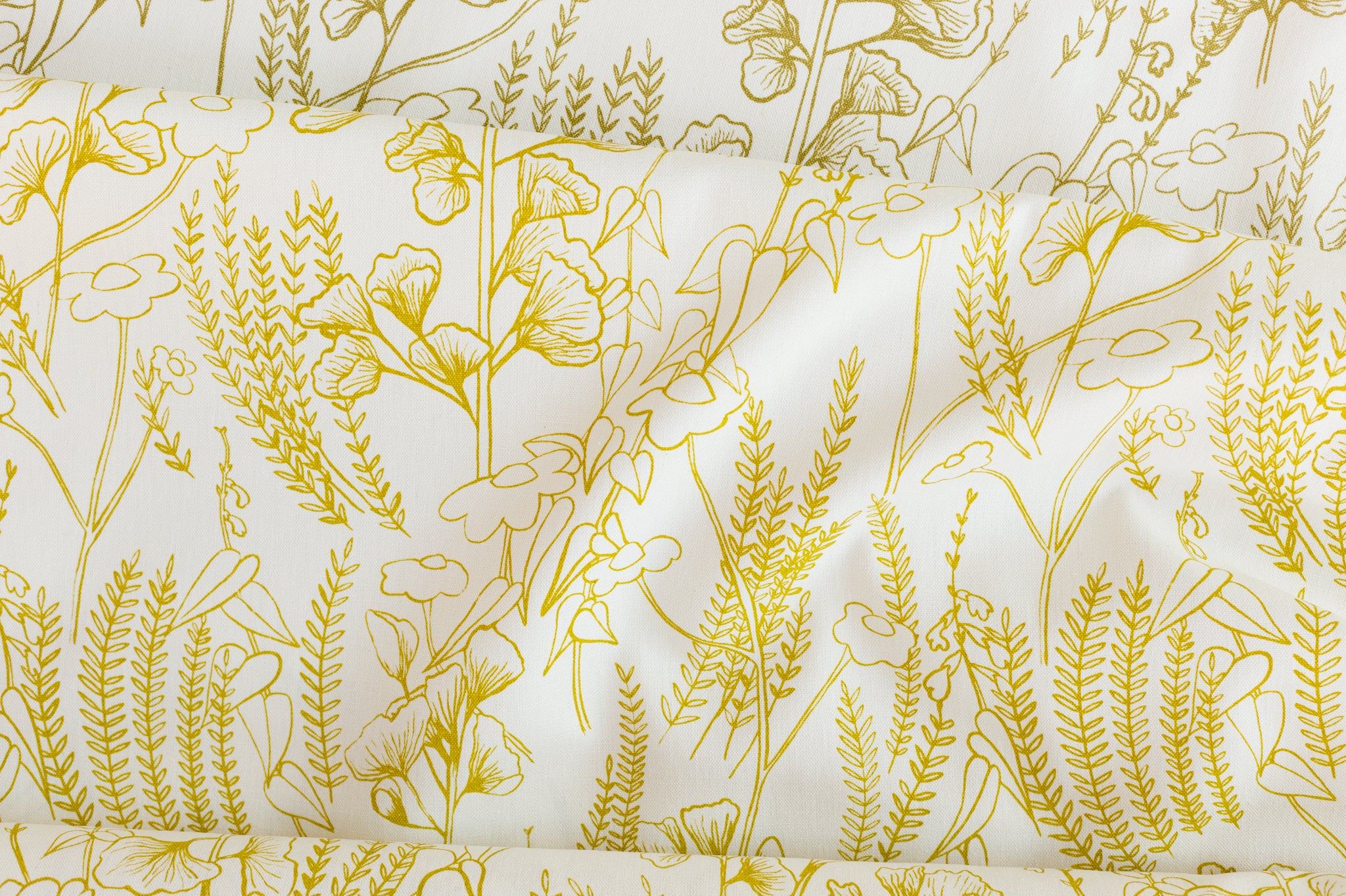 Screen printed fabric yardage with Ginkgo leaves, Mexican sunflowers, and salvia