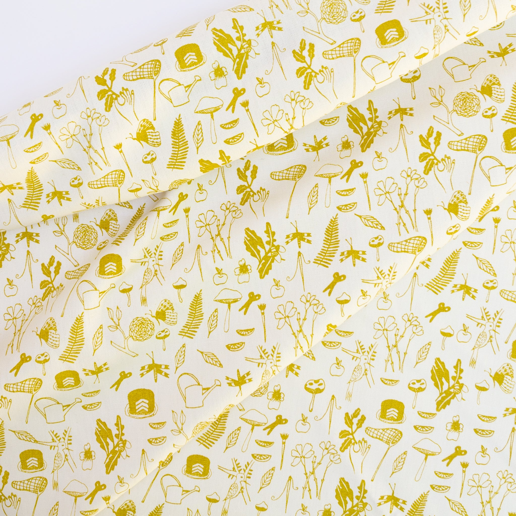Screen printed fabric yardage with little illustrations in yellow