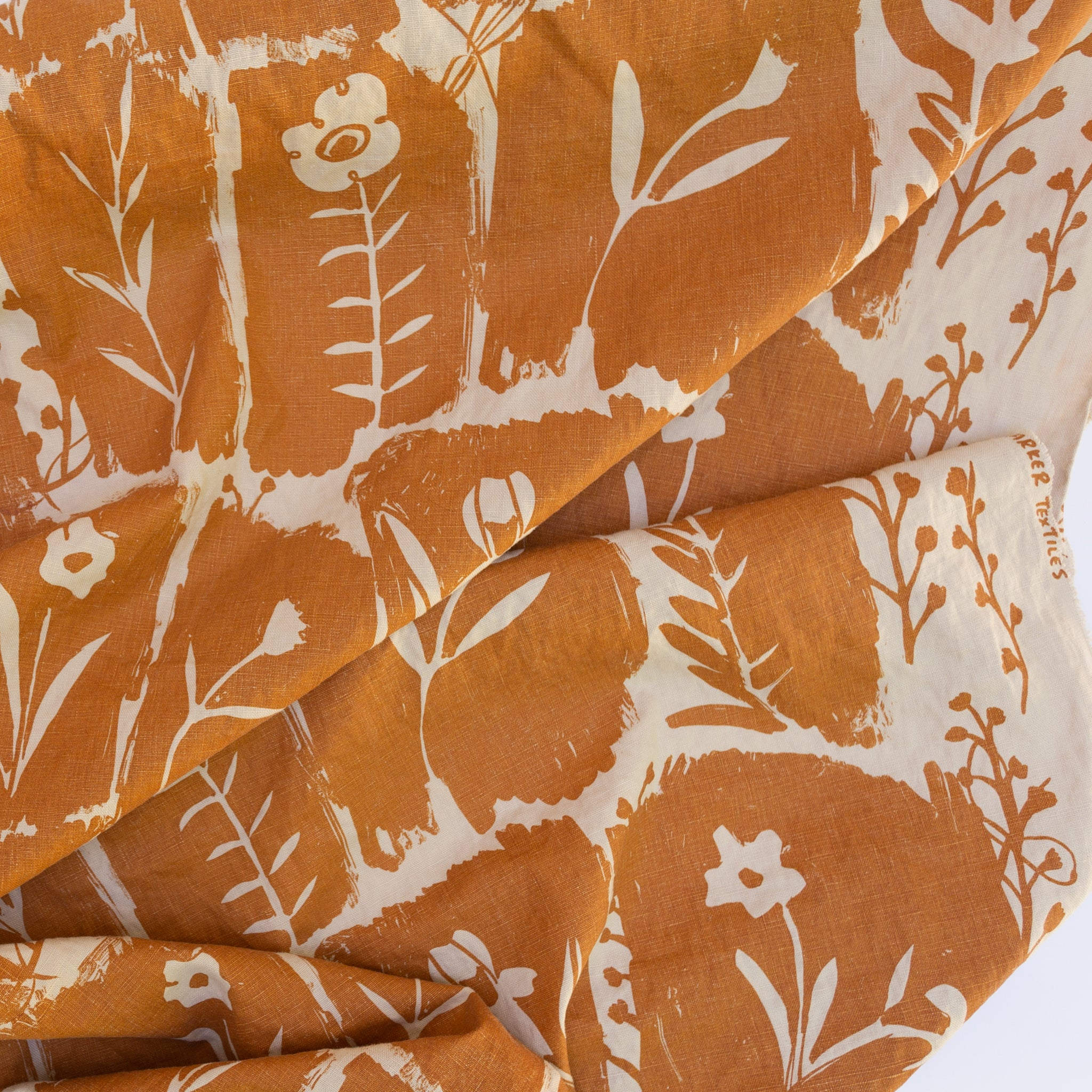 Linen fabric screen printed with Matilda in Terracotta