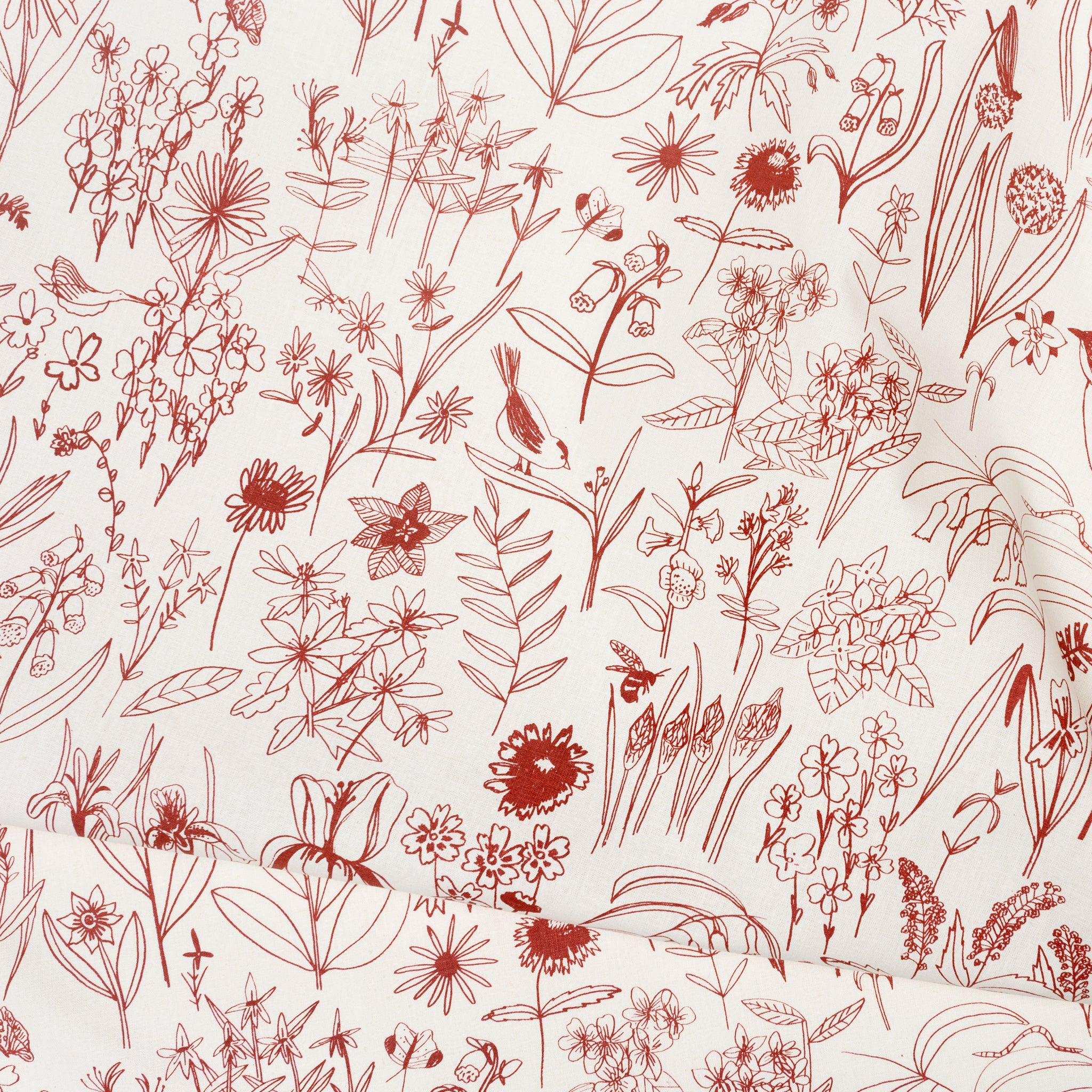 Fabric yardage screen printed with bird and botanical illustrations