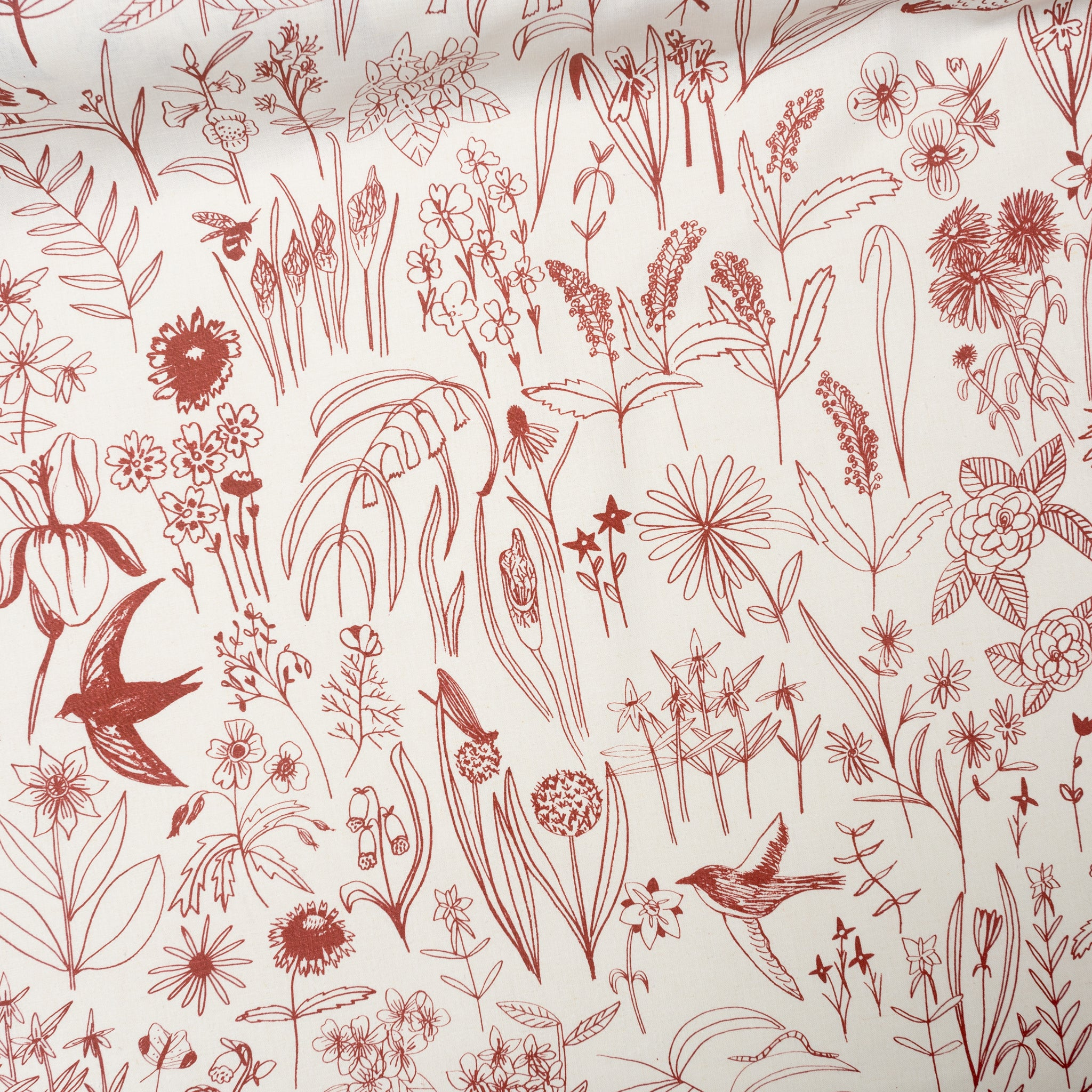 Screen printed fabric yardage of Meadowlark in Brick