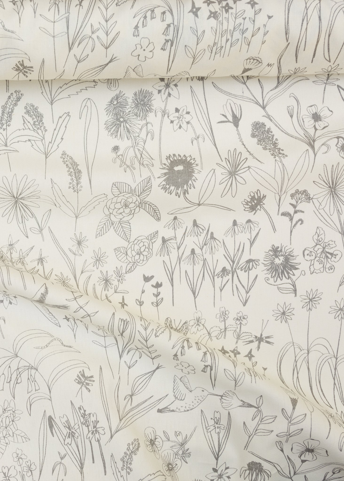 Screen printed fabric yardage with bird and botanical illustrations