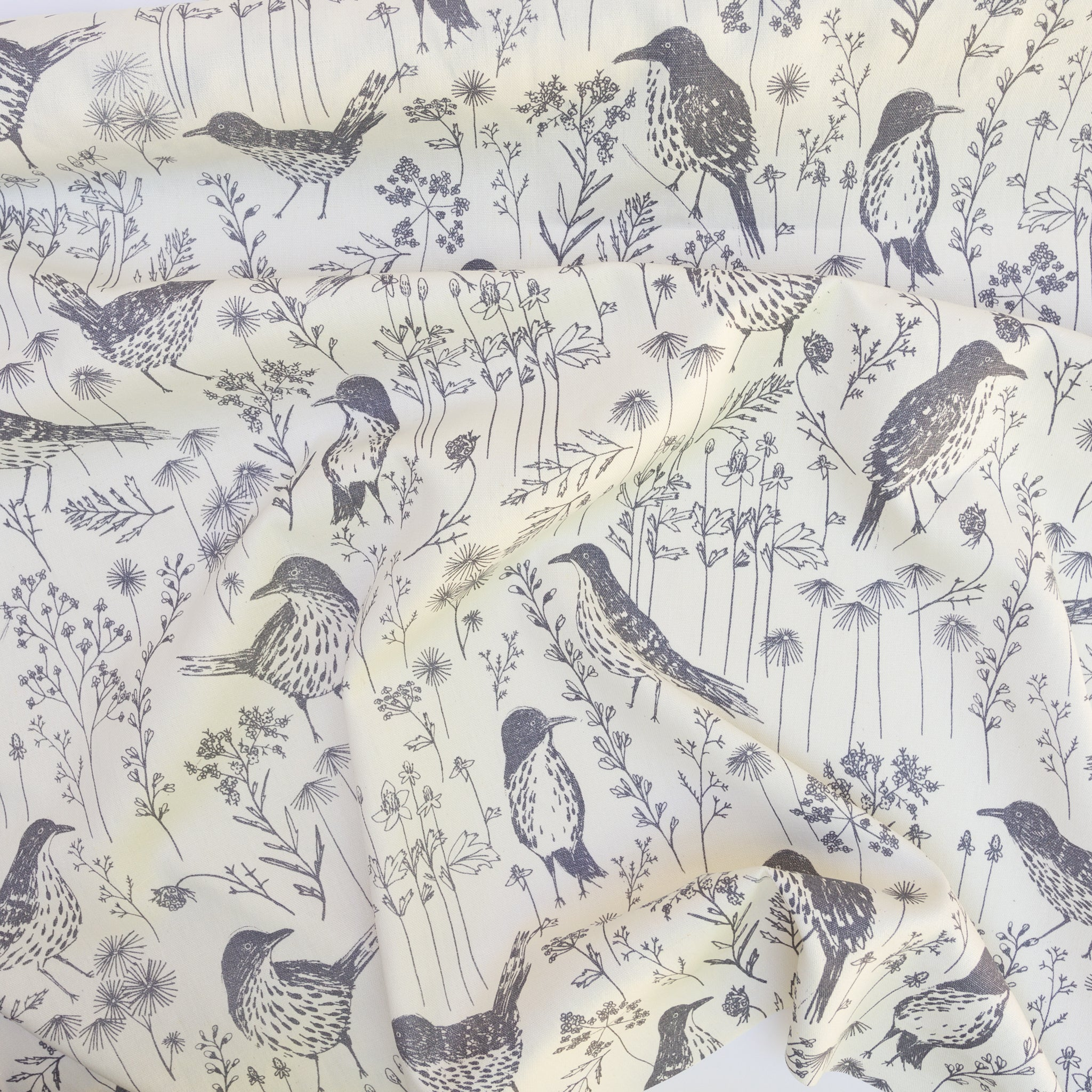 Screenprinted fabric yardage with brown thrashers by Sara Parker Textiles