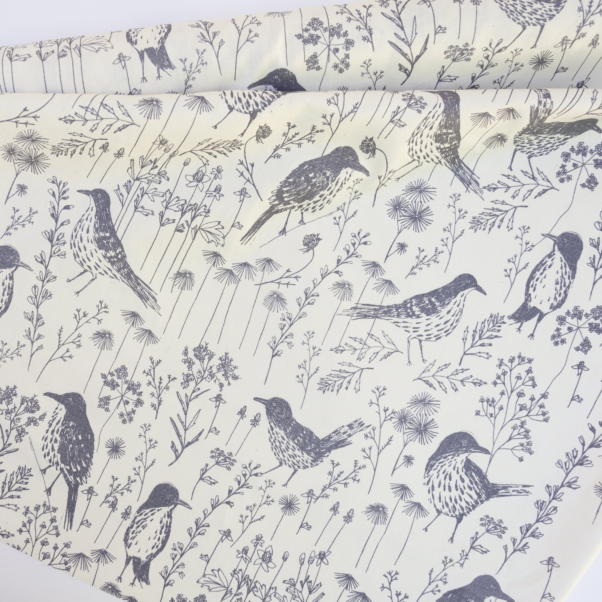Fabric yardage screenprinted with brown thrashers