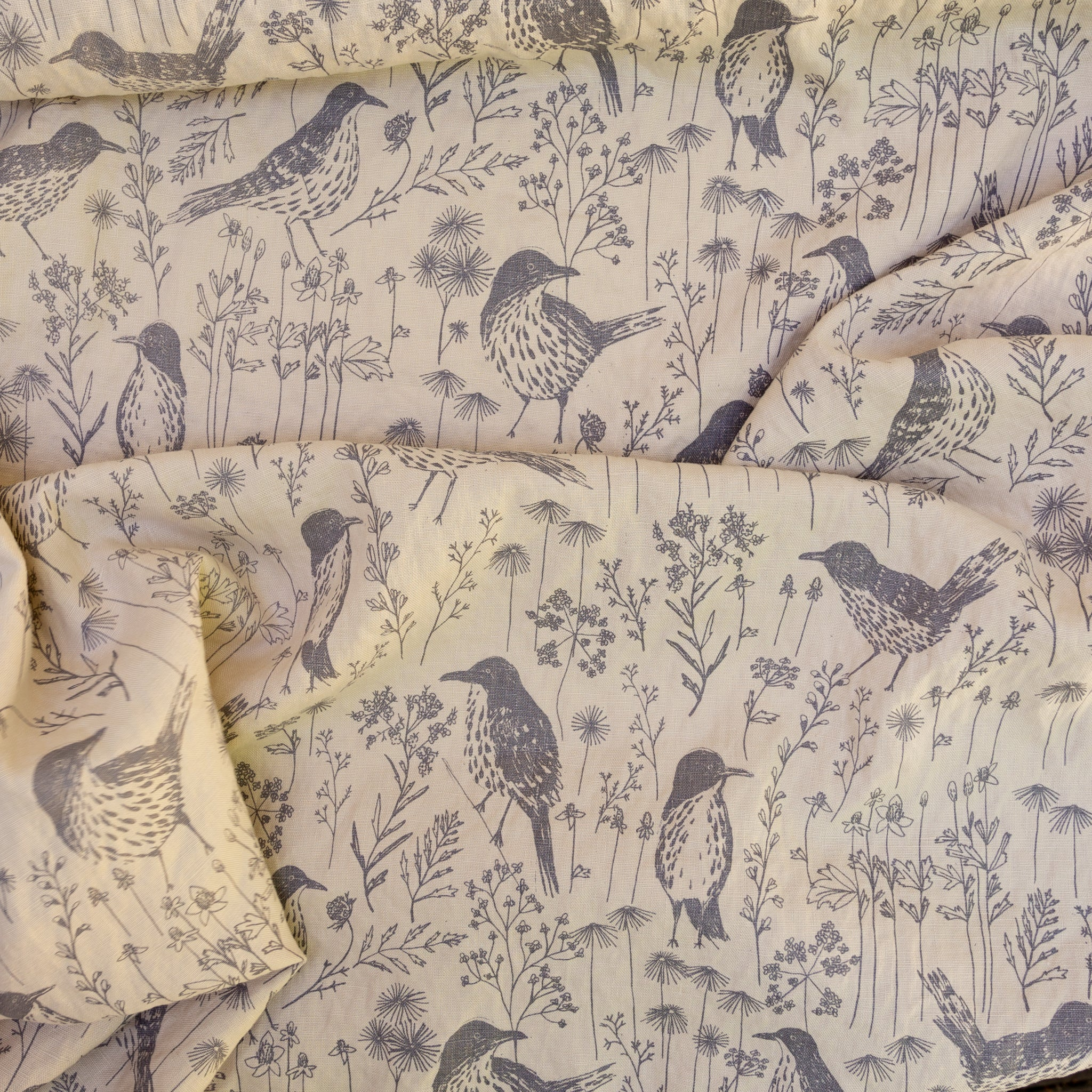 Screenprinted fabric yardage of brown thrashers by Sara Parker Textiles