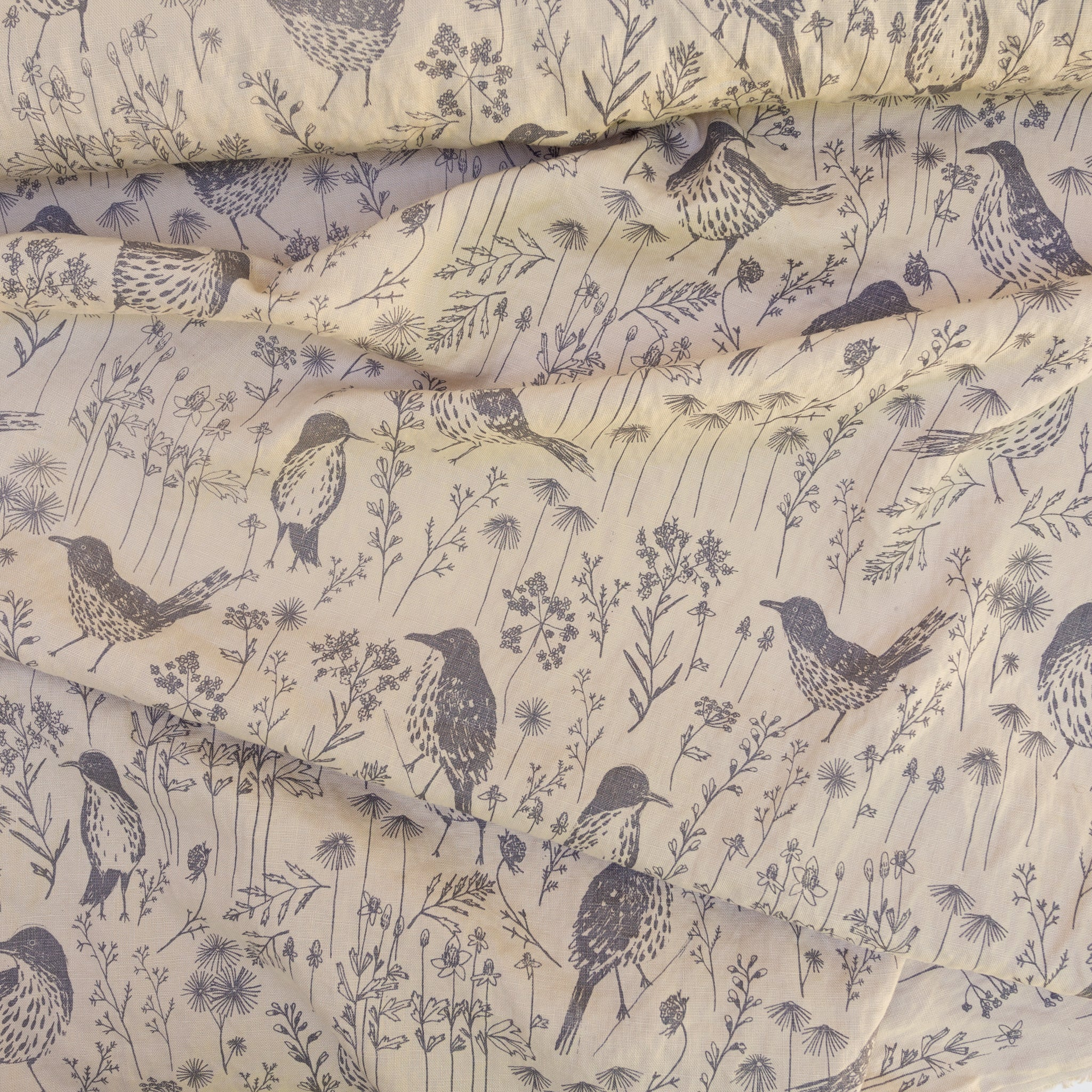 Screenprinted fabric yardage with brown thrashers
