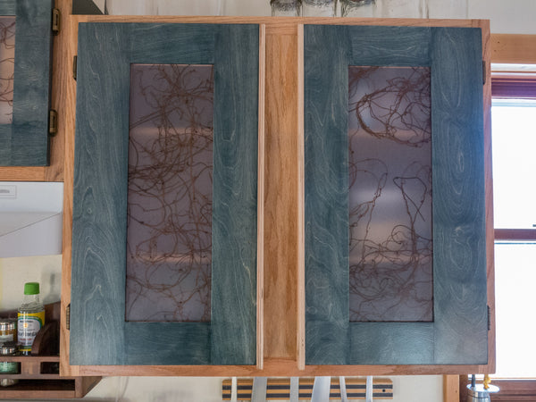 Sanded down the oak face frames and refinished them clear pained the laminate ends of the exposed boxes and made some funky doors with a decorative ... & Cabinet Doors \u2013 Blue Root Design