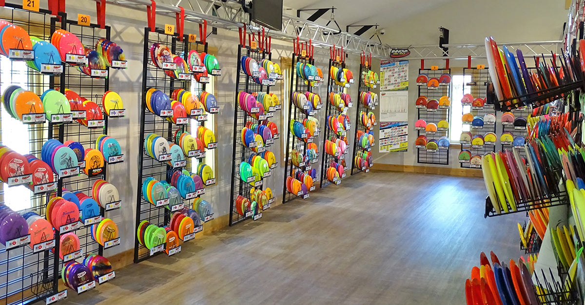 inside of the Sabattus disc golf Pro Shop with racks of discs