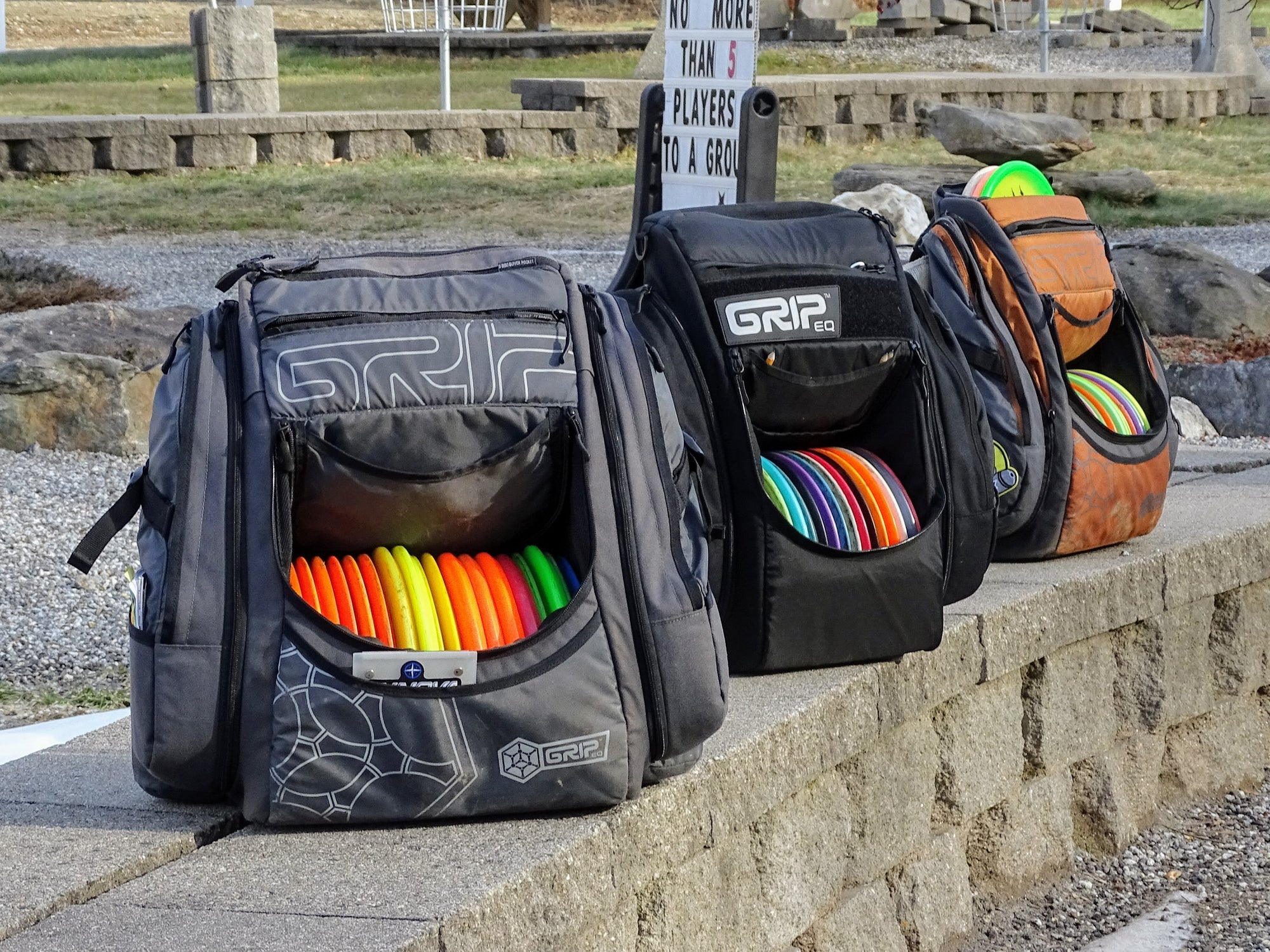 3 grip disc golf bags lined up on the wall at sabattus disc golf