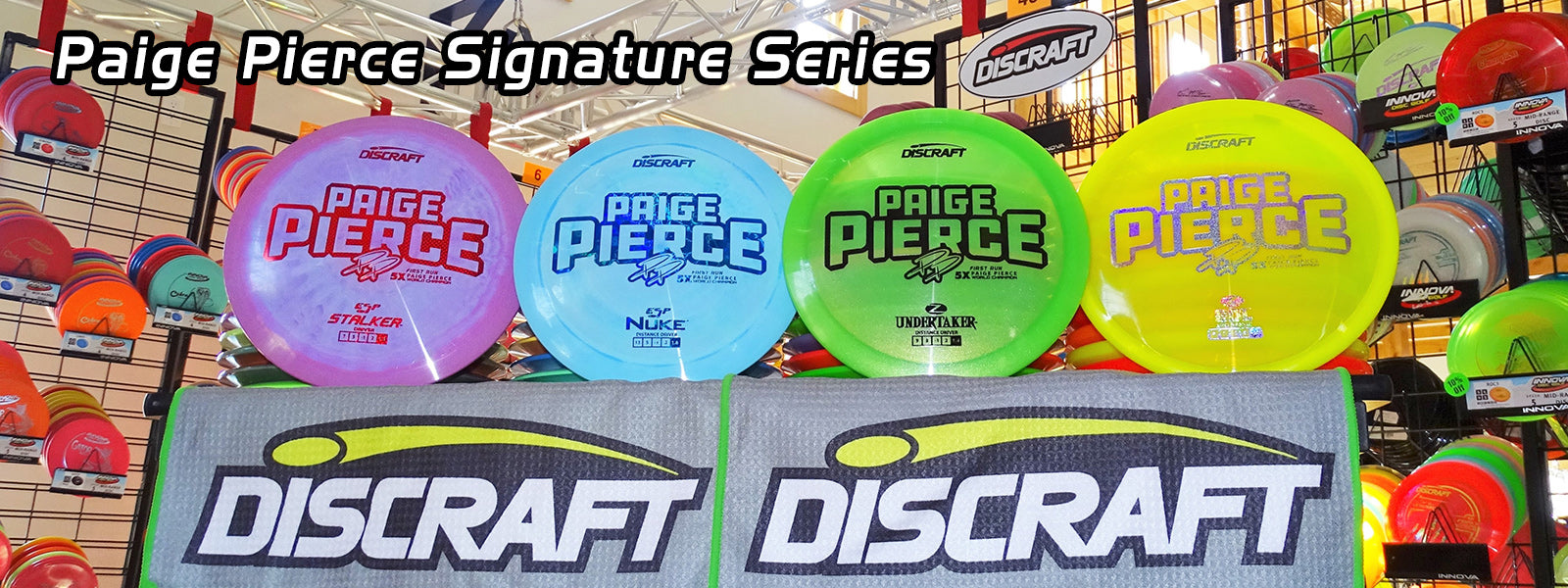Discraft paige pierce discs lined up inside sabattus disc golf pro shop