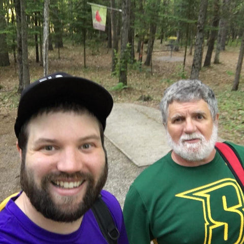 andrew & michael streeter playing disc golf together