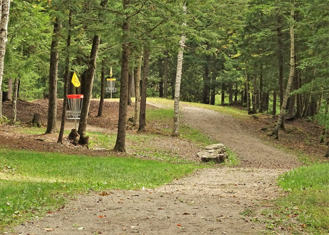 halfway down the fairway looking at the baskets of hole 10 on the Eagle / Falcon course at sabattus disc golf