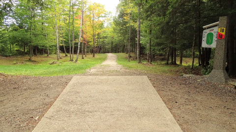 looking down the fairway from tee 10 of the eagle / falcon course at sabattus disc golf