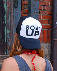 black boat up trucker hat