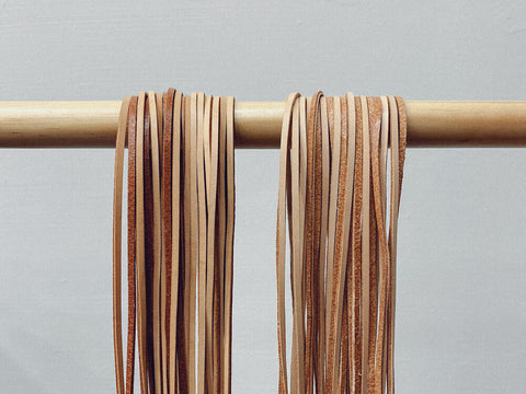Leather strips prepped for weaving