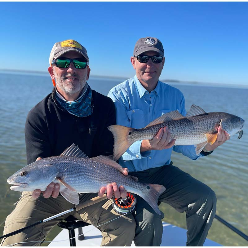 A pair of nice reds caught in the shallow, clear water with Captain Tuck Scott