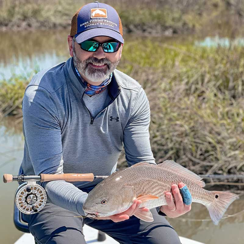 A beautiful redfish caught this week on the fly with Captain Tuck Scott