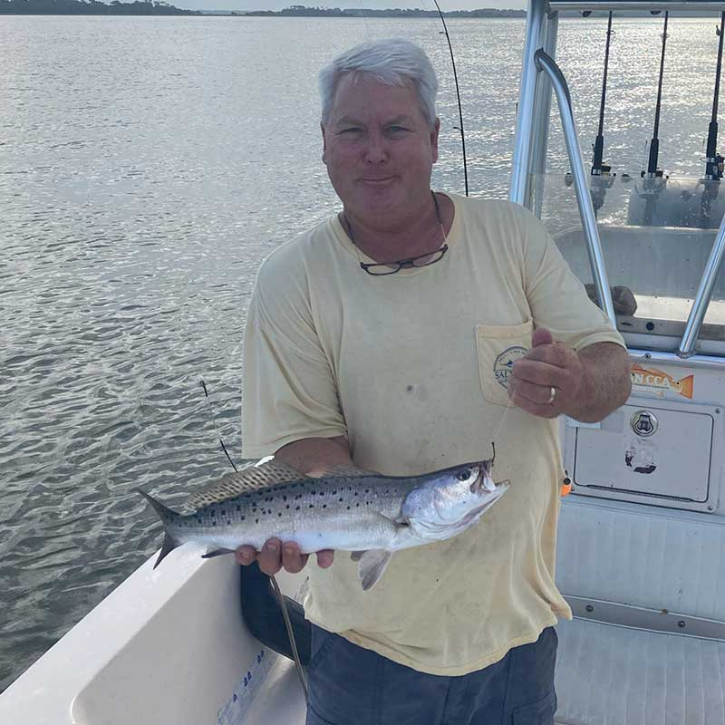 Captain Rob Bennett with a nice trout