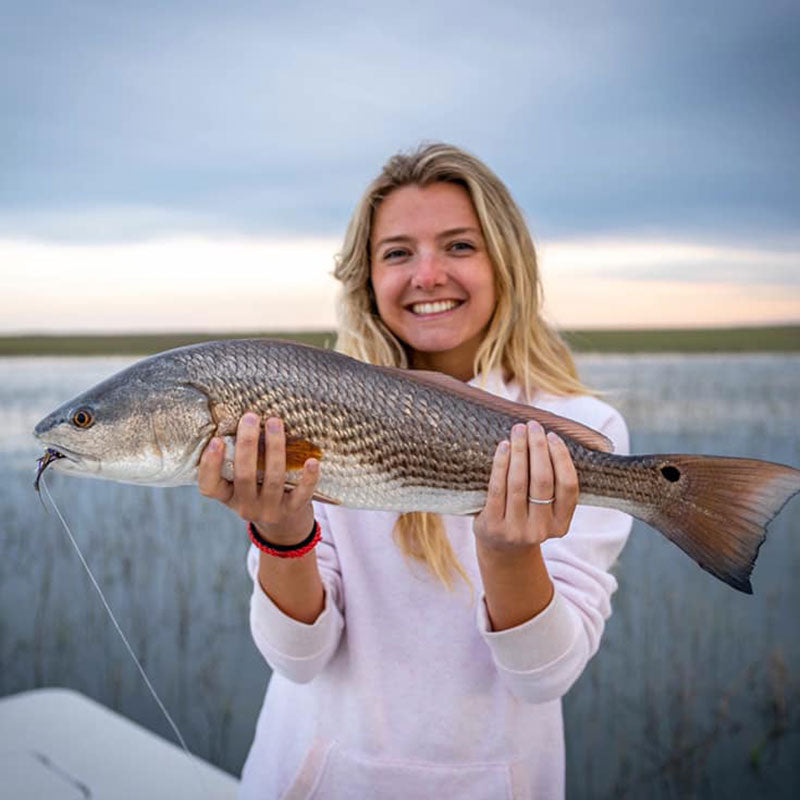 A beautiful redfish caught on the flood tide with Redfin Charters