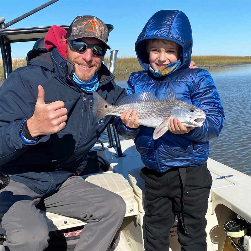 A nice redfish caught with Redfin Charters made this young angler's day