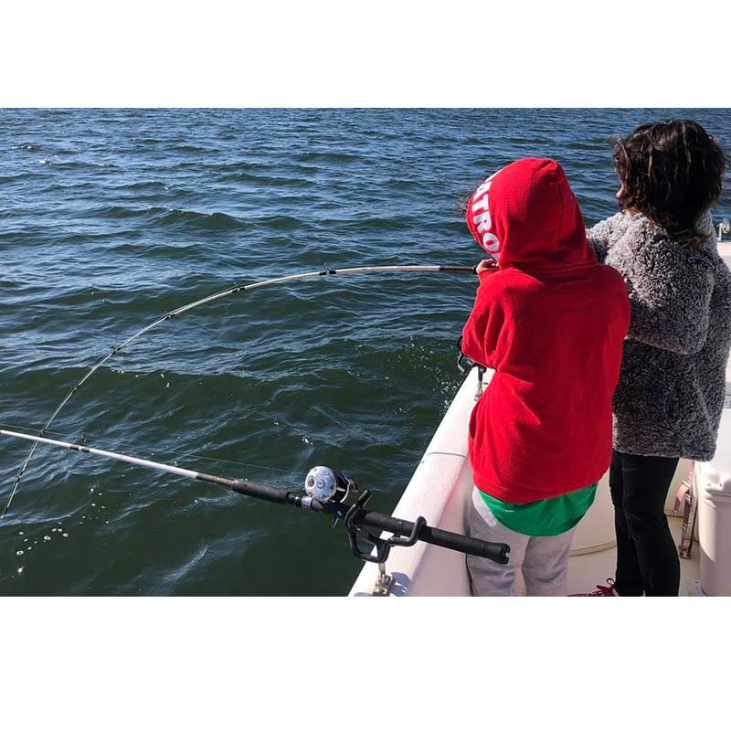 Young anglers battle their first big fish with Captain Brad Sasser